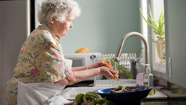 Elderly woman living confidently at home