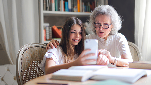 Grandmother and granddaughter using aged care technology