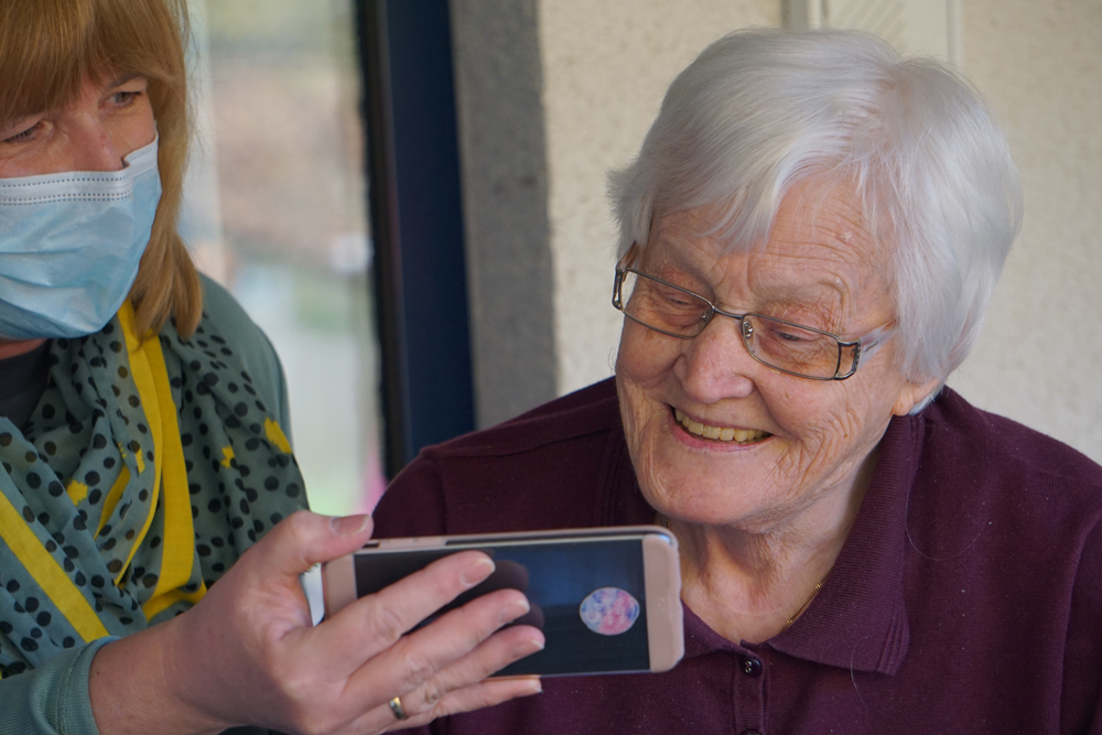 elderly person with smartphone